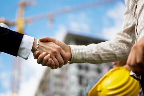 hands shaking between business person and builder